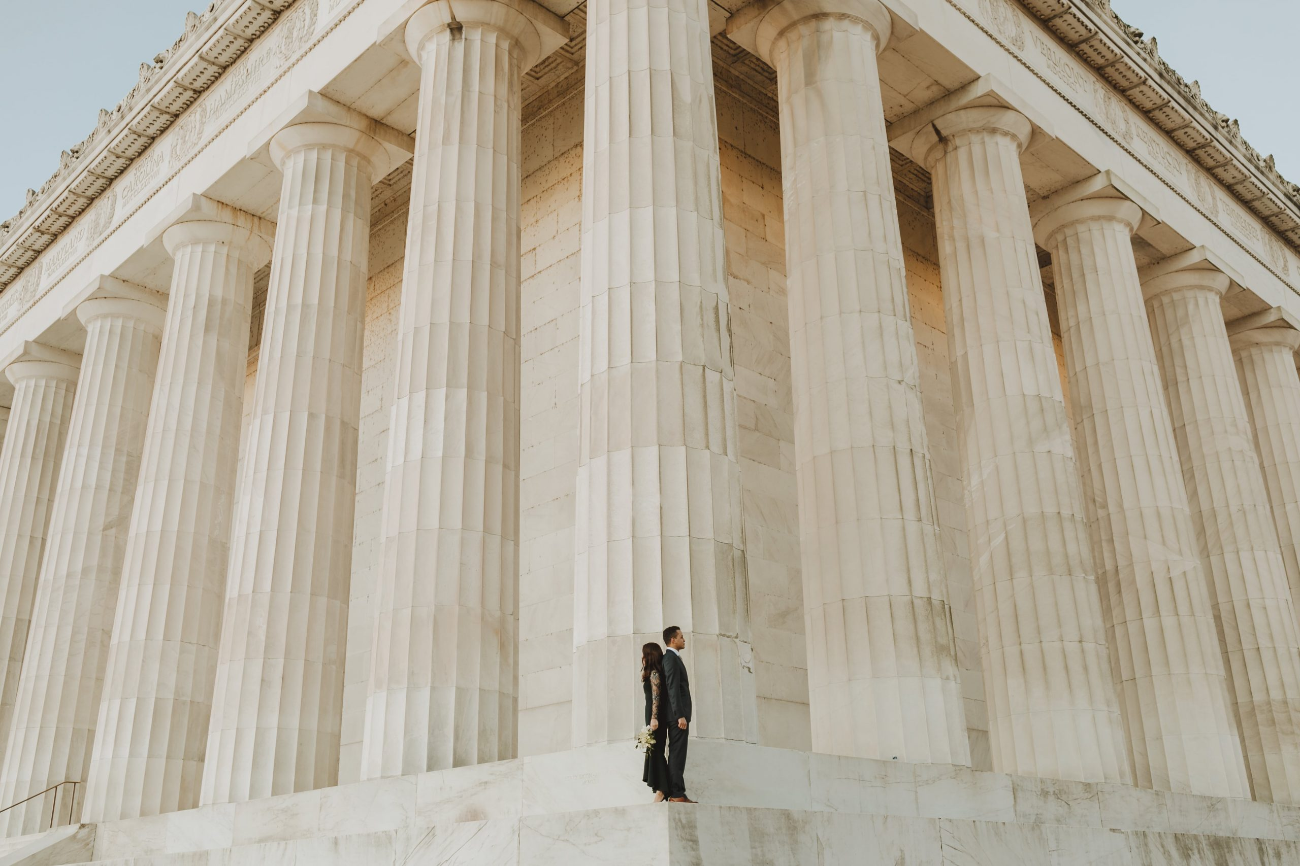 creative and modern couple in black wedding dress in front of the Lincoln Memorial, one of the best places to elope in Washington DC by Washington DC Elopement Photographer Margaret Wroblewski