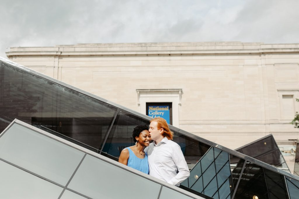 couple right in front of a sculpture