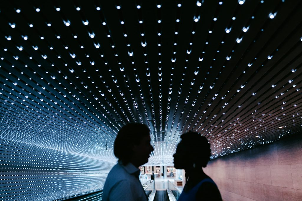 couple in front of sparkling lights